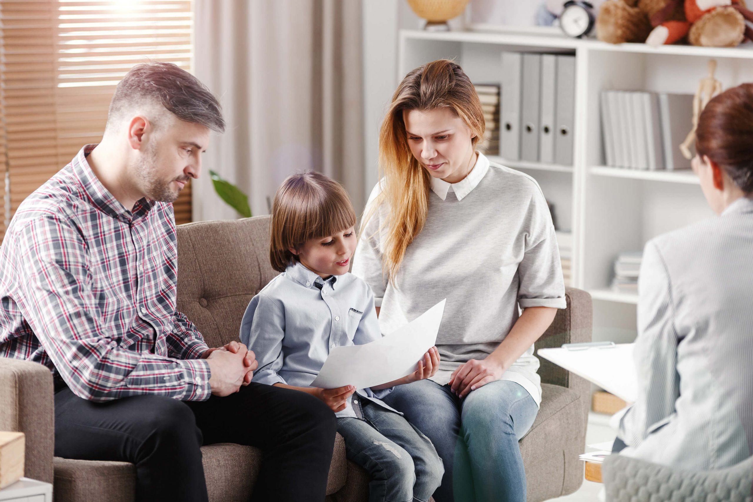Parents and child on couch